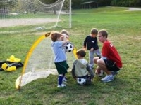 Children practicing soccer